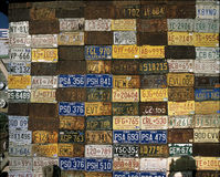 Wall of old license plates Stock Photography