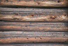 Wall of an old log house. Backgrounds or texture Royalty Free Stock Images