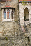Wall of old medieval castle, detail with ghotic windows Stock Photo