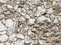 Wall of old natural tuff Royalty Free Stock Images