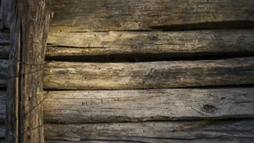 Wall of old planks of building a barn to store hay Stock Photos