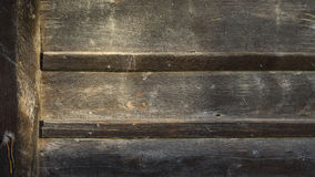 Wall of old planks of building a barn to store hay Stock Image