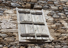 The wall of the old prison closed window with bars on the escape of criminals. Royalty Free Stock Images