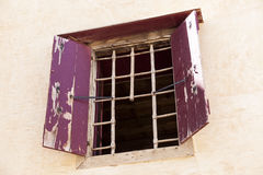 The wall of the old prison open window with bars on the escape of criminals. Stock Image