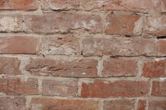 A wall of old red brick Stock Image