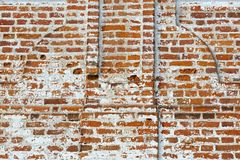Wall of old red brick with remains of light-coloured plaster Royalty Free Stock Photography