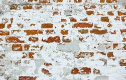 Wall of old red brick with remains of light-coloured plaster Royalty Free Stock Photo