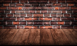 Wall of old red bricks. Background. View from dark wooden gangwa Stock Photo