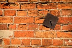 Wall of old red bricks. With an iron insert Royalty Free Stock Photos