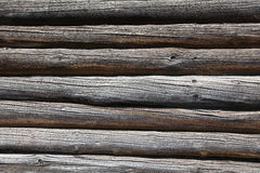 A wall of old round logs. Backgrounds from old round logs Royalty Free Stock Images