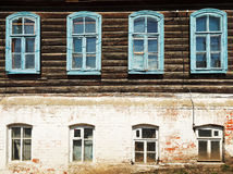 Wall of old russian urban wooden house Stock Photography