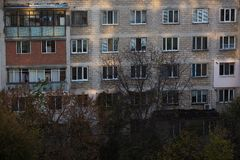 Wall of old soviet apartment building with windows stock photos