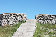 Wall of the old stone fortress. Stairs to the medieval fortress and the way up Stock Photography