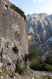 Wall of an old stone fortress by the water. In Montenegro in Kotor Stock Image