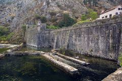 Wall of an old stone fortress by the water. In Montenegro in Kotor Stock Photography