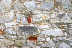 Very old wall of medieval natural stones Stock Photo