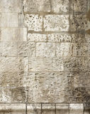 Wall of an old temple. The stones damaged by time. Very old wall Stock Photo