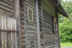 Wall of old wooden house in the village, the logs were built to last Stock Photos