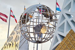 Wall with Olympic medals and globe statue Royalty Free Stock Photos
