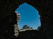 A wall opening with a view of the Rock of Cashel stock photography