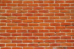 Wall of orange annealed bricks Royalty Free Stock Image