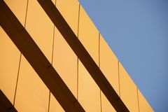 Wall of orange building against blue sky Stock Image