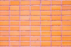 Wall orange glazed tiles Stock Photos