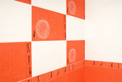 Wall with orange tile in  modern bathroom Royalty Free Stock Photo