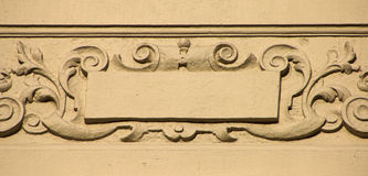 Wall ornament. On a historic building in central London, England Stock Photo