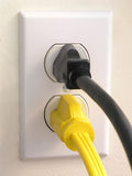 Wall Outlet - Black Yellow Plug Royalty Free Stock Photo