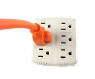 Wall Outlet with Orange corded Plug Royalty Free Stock Photography
