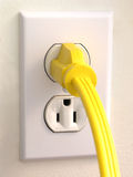 Wall Outlet - Yellow Plug Stock Image