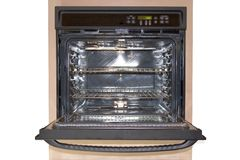 Wall Oven Front - Isolated. Black electric wall oven with door open and racks exposed Royalty Free Stock Photography