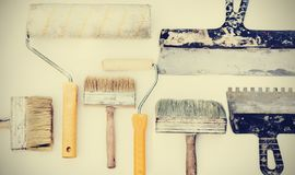 Wall paint brushes and imstruments for painting on the white background, well used with copy space for text.  stock photo