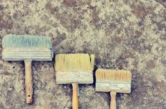 Wall paint brushes on the sidewalk, well used with copy space for text.  stock image