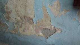Wall paint peeled on old brick Stock Photos
