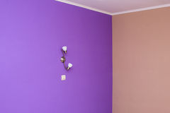 Wall painted in bright color and wall lights Stock Images