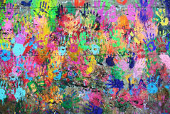 Wall painted colorful background with hand prints Royalty Free Stock Images