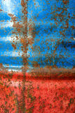 Wall painted metal barrels with rust Stock Photos