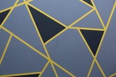 Random geometric pattern. The wall is painted with a random geometric pattern royalty free stock photo