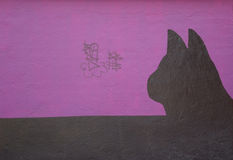 Wall with painted silhouette of a cat. Wall with the painted silhouette of a cat Royalty Free Stock Photos