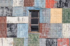 Wall of painted tin squares royalty free stock photography