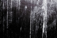 Wall painted white color on black concrete. Wall concrete texture and splash brush or abstract background. Image hi contrast Stock Photography