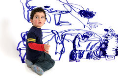 Wall painting. Young artistic boy doing wall painting stock images