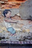 Wall painting of boy playing kite Stock Photo