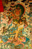 Wall painting in Buddhist temple. Buddhist temple decorated with divine figures royalty free stock photos