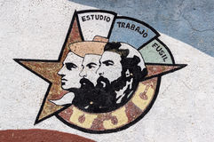 Wall painting of cuban revolution heroes. A wall painting of the 3 main revolution heroes in Havana, Cuba. Juan Antonio Mella, Camilo Cienfuegos, Ernesto Che stock photography
