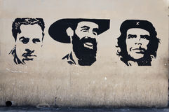 Che Guevara wall painting. Wall painting showing the three main cuban heroes (Juan Antonio Mella, Camilo Cienfuegos and Che Guevara) in Havana, Cuba royalty free stock image