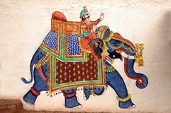 Wall painting of Elephant at City Palace, Udaipur. Beautiful, artistic, colourful, Wall painting of an elephant running as per instructions of his mahavat at stock photos