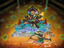 Wall Painting of God Sitting over Horse. Wall painting of a god sitting over a horse at city pillar shrine of Chiangmai province, Thailand Stock Photos